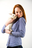 Portrait of sexy woman posing in studio with rabbit — Stock Photo