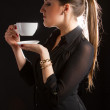 portrait of beautiful woman posing in studio with cup of coffe — Stock Photo