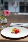 Image of tasty salmon on dish with white vine — Stock Photo