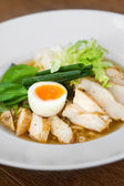 Image of tasty soup with chicken and egg in dish — Stock Photo