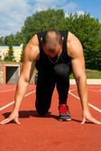 Image of muscle man ready to run — Stock Photo