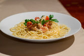 Image of tasty pasta with salmon and herbs — Stok fotoğraf