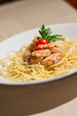 Image of tasty pasta with salmon and herbs — Stock Photo