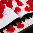 Piano keys and musical book — Stockfoto #37145245