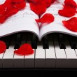 Piano keys and musical book — Photo #37145265