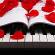 Piano keys and musical book — Stockfoto #37145265