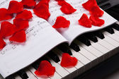 Piano keys and musical book — Stockfoto