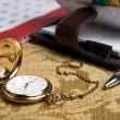 Gold pocket watch and a wall calendar and sketchpad — Stock Photo #38365655