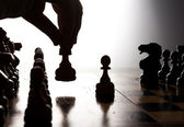 Man makes a move chess figure — Zdjęcie stockowe