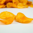 Handful of corrugated potato chips — Stock Photo #39020855