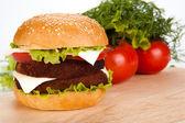 Big hamburger still life on a white background — Stock Photo