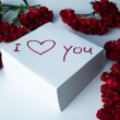Notebook with marker inscription I love you and roses — Εικόνα Αρχείου #39878413