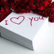 Notebook with marker inscription I love you and roses — Εικόνα Αρχείου #39878421