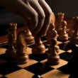 Stockfoto: Mmakes move chess figure