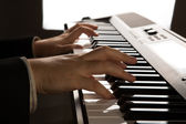 Piano keys and human hands — Stock Photo