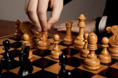 Man makes a move chess figure — Stock Photo