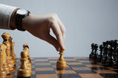 Man makes a move chess pawn — Stock Photo