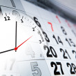 Wall calendar with the number of days and clock — Stock Photo #40169149