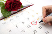 Man escorts date in calendar — Stockfoto