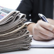 Stock Photo: Stack of newspapers in office close-up
