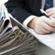 Stack of newspapers in office close-up — Stock Photo