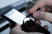 Human fingers on the smartphone — 图库照片