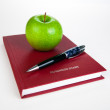 Stock Photo: Business diary with pen and green apple