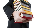 Man holding a stack of books — Stock Photo