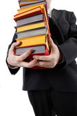 Man holding a stack of books — Stockfoto