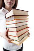 Young girl holding a stack of books — Stockfoto