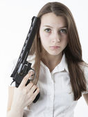 Young girl holding a pistol — Photo