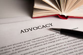 Document with the title of advocacy — Stock Photo