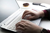 Human hand on the notebook keyboard  — Photo