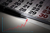 Wall calendar with pen closeup — Стоковое фото
