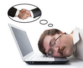 Employee at the computer dreaming agreement — Stock Photo