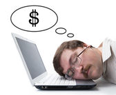 Employee at the computer dreaming currency — Stock Photo