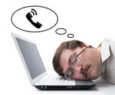 Employee at the computer dreaming that he call — Stock Photo