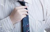 Hand business man straightens his tie — Stock Photo