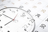 Sheet of a calendar with the number of days and clock — Stock Photo