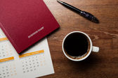 Diary with large pen on the oak desk — Stockfoto
