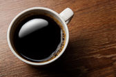 Cup of black coffee on the desk — Stock Photo