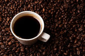 Cup of black coffee with roasted coffe beans — Stock Photo