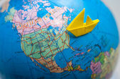 Paper ship on sea go to america — Stock Photo