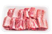 Frozen pork rib in the foam tra — Stock Photo