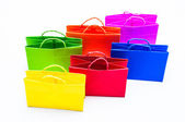 Colourful paper shopping bags isolated on whit — Stockfoto