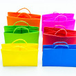 Colourful paper shopping bags isolated on whit — Stock Photo