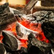 Decaying coals for cooking and a background — Stock Photo