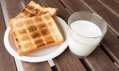 Fresh milk and Toast a slice of bread — Stock Photo
