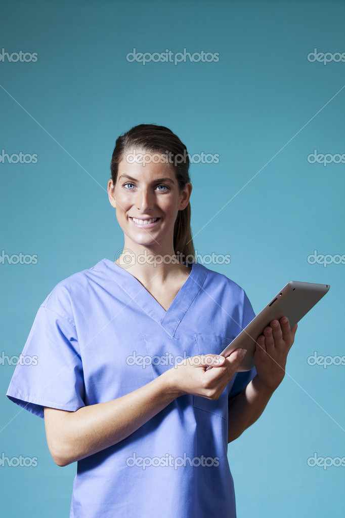 Attractive young female doctor holding an electronic tablet device — Stock Photo #16902823