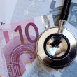 Euro notes and stethoscope - Stock Photo